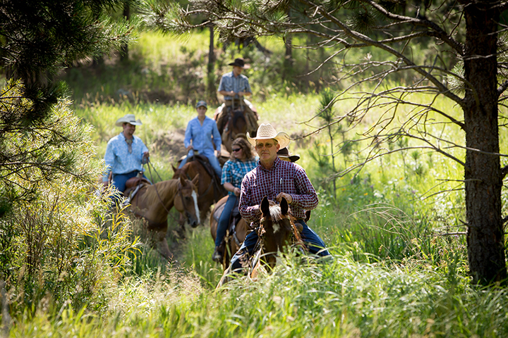 Close up of several people on a trail ride
