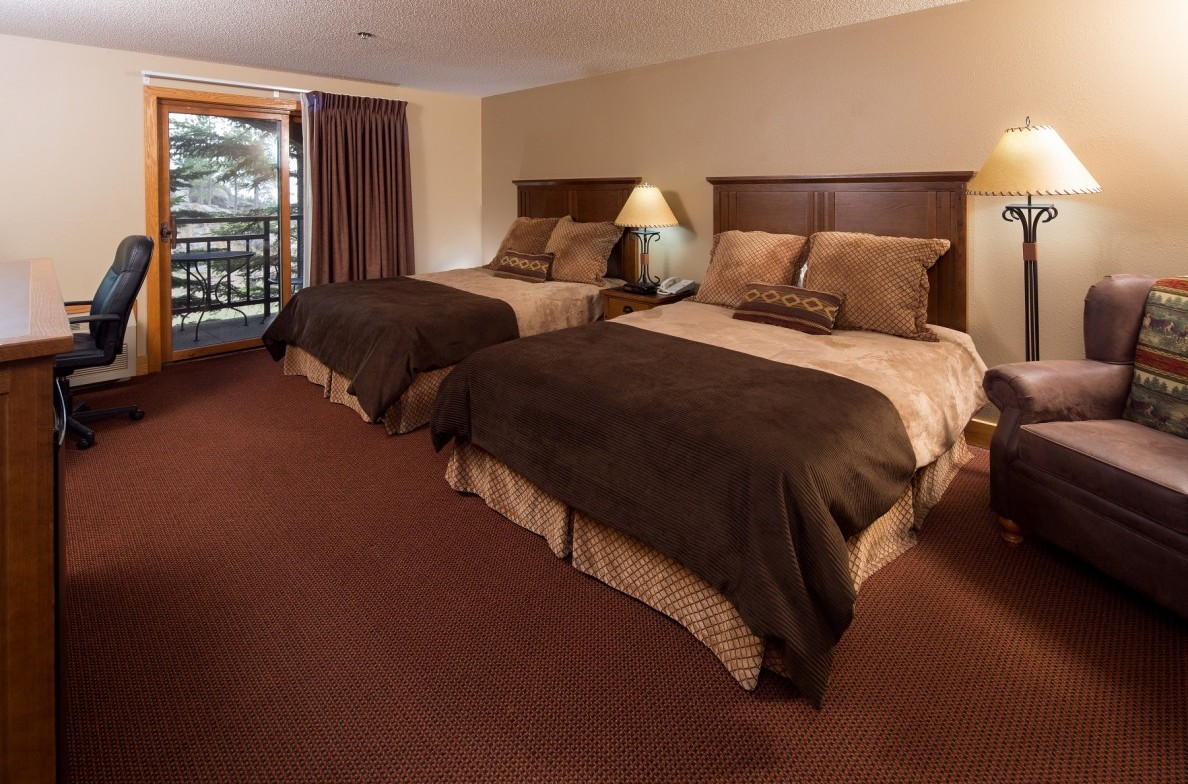 Comfortable lodge rooms offer balconies with forest views.