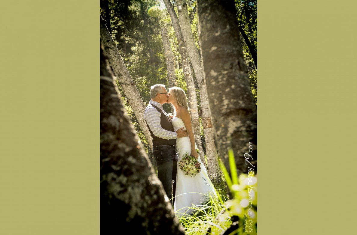 Couple kissing among the trees